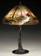 Lot #1346, a Handel Stream Scene table lamp, realized $17,775.