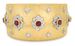 Lot #1510, a Buccellati 18kt gold, ruby & diamond bracelet, realized $23,700.