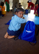 Nepali child receives solar-powered lights and school supplies