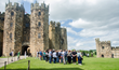 Guests tour a variety of filming locations, including Alnwick Castle in England.