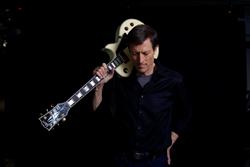 Neal guitar on shoulder