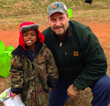 Pastor Howard with a young boy who received a coat at a previous event where Winter Survival Kits were distributed.
