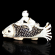 Boy riding a fish, one of the classical ceramic bargains in Gianguan Auctions' December 10 sale.