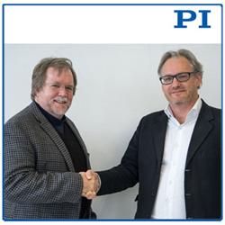 Scott Jordan (left) and PI's VP,  Sales & Marketing, Stephane Bussa (right)