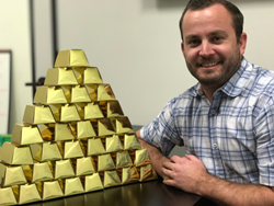 Meyer poses next to the 35 gold items he will be hiding in an undisclosed Inland Empire location on Dec. 14.