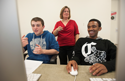 Laura Gurney (center), assistant professor of webmedia at Husson University will be teaching students how to code.