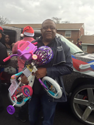 Optima Health volunteer gives toys to children during the parade.
