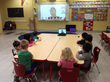On Tuesday, Dec. 6 preschoolers at Stratford School in Altadena, Calif., listen as Middle Schoolers hundreds of miles away in Sunnyvale  in the Bay Area help them learn computer coding fundamentals in