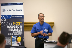 Image of Mike Fong addressing customers at the company's fall leadership summit.