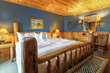 Lodge rooms and cabins at Brooks Lake Lodge & Spa boast warm inviting interiors for relaxing after a long day outside enjoying snowy activities.