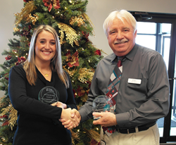 Katie Quam, EMC's manager of customer incentives receiving two awards at the Duke Energy event in Plainfield, Indiana