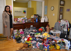 Stephanie Castillo, a former resident of Hillsides, a foster care charity, returned to her former home with holiday toys for the children.