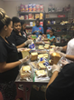 LoveLife Family Services dedicated team members work together to provide Thanksgiving Lunch to the homeless in the community