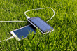 It adds solar panels to both sides of the device and uses them to gather solar energy to power the battery.