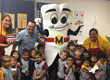 Juan Molano and Mighty MolarMan talk oral health with the children.