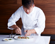 Executive Chef Titus Wang plating one of his creations.