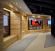 A Chicago company that analyzes consumer data for retail and entertainment venues, welcomes visitors with American Gothic Ash paneling and benches.