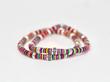 African Jigida bead stretch bracelets with fine silver and diamonds