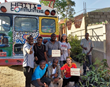 Pierre-Moise Louis and team transporting the 100,000th food-bearing TTFF tree to Jeremie