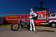Doug Danger poses with his 1972 Harley-Davidson XR750 and Knievel's Big Red.