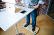 Worker using balance board at the office
