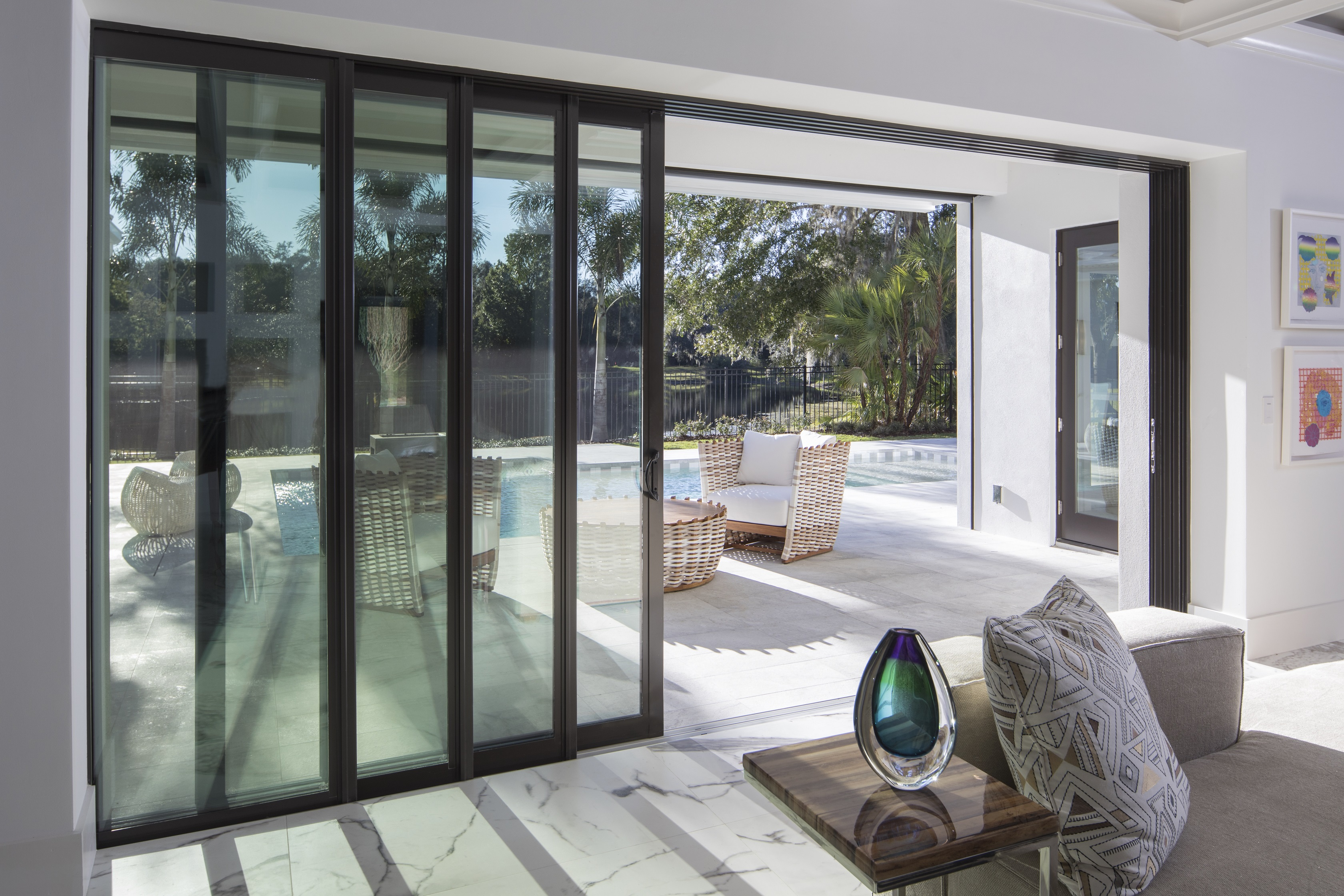 Ply gem windows and patio doors enhance architectural for Exterior sliding glass wall system