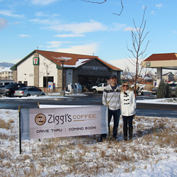 Ziggi's Coffee franchisees, Steve and Jill Anderson, stand in front of a sign at the site of their new drive-thru location on the corner of 43rd St. and Taft in Loveland, Colo.