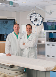 Neurovascular surgeons Ricardo Hanel, MD, PhD, (left) and Eric Sauvageau, MD