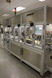 Image of an automated assembly system by Demco Automation that includes motion control, vision inspection and customized tooling.  Custom processes are developed for industry sectors such as medical device, commercial-industrial, and defense.