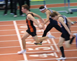 Jackson Thorne (left) blazes across finish line to clinch the league championship in 55-meter dash at the Armory Track & Field Center in New York City.