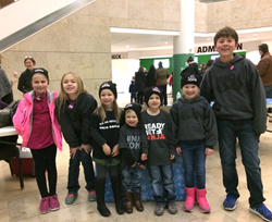 NinjaZone kids participate in food and toy drive.