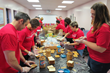 Wells Fargo volunteers worked as a team to assemble 500 PB & J sandwiches for distribution in Eva's Community Kitchen this fall, while others served a hot lunch to nearly 400 guests.