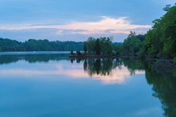 Photo of Melton Lake, near Oak Ridge, Tennessee, which is calm and glass-like.