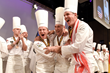 Team USA learns that they have just won the 2017 Bocuse d'Or in Lyon, France. From left to right: Team USA Coach Philip Tessier, Team USA Chef Mathew Peters & Team USA President Thomas Keller. (c) SIR