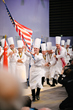 Team USA Commis Harrison Turone carries the American flag after his team was announced as the winner of the 2017 Bocuse d'Or. (c) SIRHA 2017