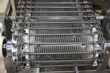 Cambridge Engineered Solutions CamEDGE MORE cageless spiral conveyor belt with mesh overlay