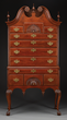 Chippendale Cherrywood Bonnet-Top Highboy, Estimated at $75,000-150,000.