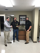 Fred Tull presents Project Superintendent Jack Walters and Project Manager Micheal Powers with the award.