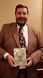Jean Paul Peron with the plaque he was awarded Realtor® of the Year by the Outer Banks Association of Realtors.