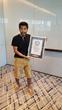 Suneet Jain holding the Guinness certificate