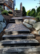 This project involved a slope and rockery surrounding the work space. Despite the challenges, Pacific Landscape Management installed an irrigation system, a paver patio and walkway and steps.