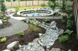 Rock Solid Landscapes, LLC was tasked with the goal of providing an environment of year-round creativity and exploration for a family and their young kids. They created a series of inviting pathways, a dry creek bed, and an incredible sand play area.
