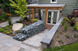 Britescape removed an unused driveway and expanded the outdoor living space by adding a sunken covered patio.  Britespace also added a walkway, a gabion retaining wall, lighting, and beautiful drought-tolerant plantings.