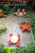"With aging atrium at Physio Control in Redmond, WA  needing an overhaul, Plantscapes removed and replaced old trees, deteriorating hardscape, and 12""of soil. They completed the project by adding irrigation, lighting, a fountain, and new plants."