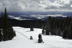 two snowmobile riders in Grand County, CO