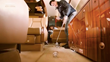 Michael Wong practising golf on a private jet