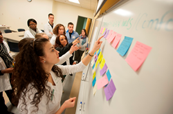 Students work in teams to develop interdisciplinary health plans for a patient as part of Husson University's Interprofessional Evening of Conversation.