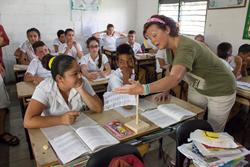 Female traveler in classroom in Cuba during volunteer tour