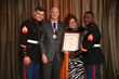 Dr. J. Tracy Mills OF Mills Dental Group, From Houston Texas Joined Forces With U.S. Marines Toys For Tots Literacy Campaign To Combat The Scourge Of Illiteracy