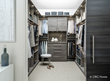 An ORG Home custom closet with clean lines, stylish hardware and an elegant two-tone color scheme keeps your space feeling calm and serene.